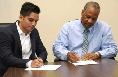 iMAGE: LUCELEC's Managing Director, Trevor Louisy, and a GRUPOTEC representative at the contract signing ceremony.