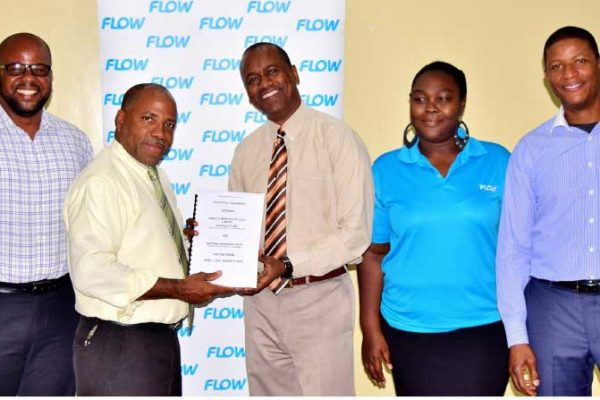 Image: Labour Commissioner Ray Narcisse (second from left) and Flow Country Manager Chris Williams (third from left) present the NWU collective agreement with Flow colleagues.
