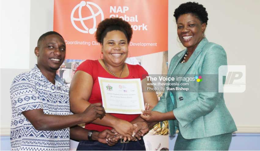 Image: Choice Television reporter, Janelle Norville, (centre), receives her winning certificate from MASL President, Miguel Fevrier, (left), and Permanent Secretary, Valerie Leon, (right). [PHOTO: Stan Bishop]