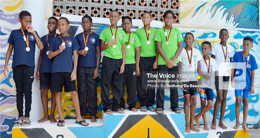 Image: (l-r) Relay winners in the Under-11 Boys category: Racers (bronze), Lightning (gold) and Sea Jays (silver). Photo: Anthony De Beauville)