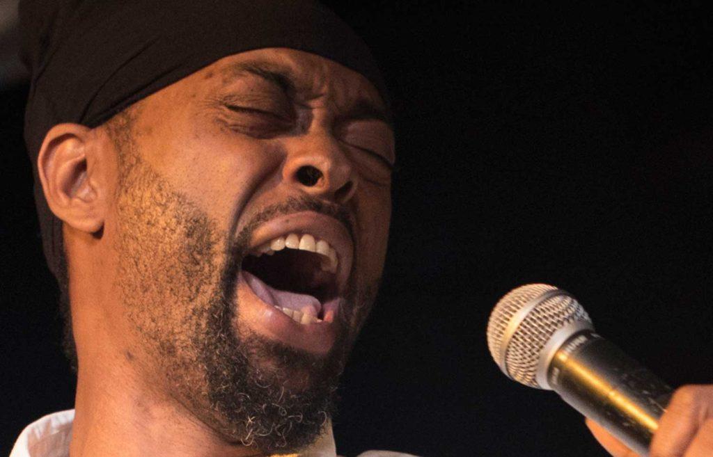 Image of TC Brown, calypsonian from the Ambassadors Calypso Tent.