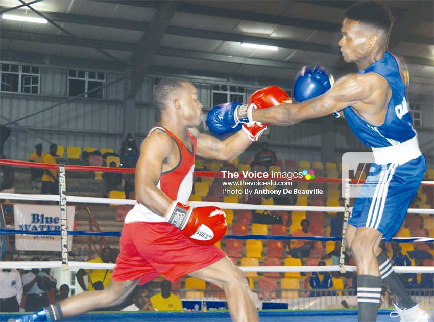 Image: Barbados' Jabali Breedy (in red) against Jamesy Greenaway of Dominica. (PHOTO: Anthony De Beauville)