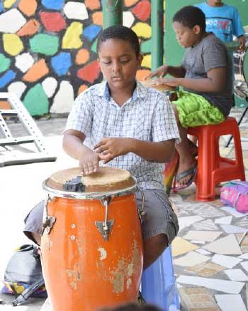 Image of boys learning drum skills.