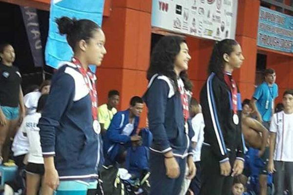 Image of Saint Lucia's Katie Kyle receiving her bronze medal; Kyle, third from left. (Photo: TSLU)