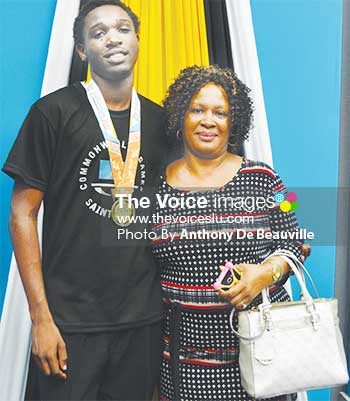 Image of Saint Lucia's lead goal scorer (7) Linus Clovis shares a photo moment with his mother, Lindel Clovis. (PHOTO: Anthony De Beauville)
