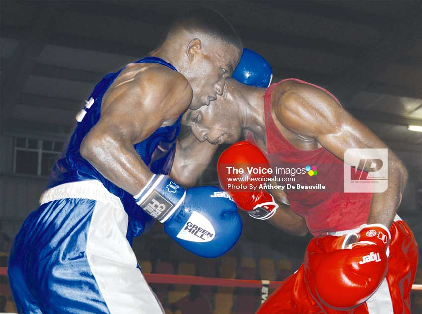 Image: Saint Lucia's Nathan Ferrari versus Justin Edwards of Barbados. (Photo: Anthony De Beauville)