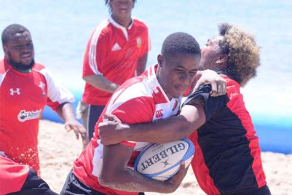 Image: Some of the action during the Carnival 7s tournament played on Sunday at the Vigie beach. (PHOTO: DP)