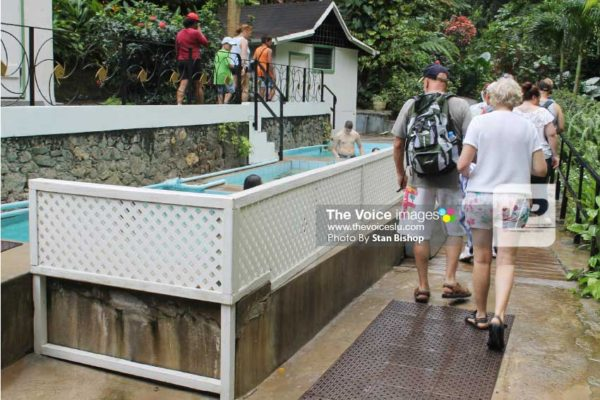 Image of tourists at the mineral baths in Soufriere. [PHOTO: Stan Bishop]