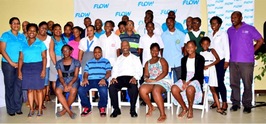 Image: Flow scholars and reps and Msgr. Anthony pose for a group photo.