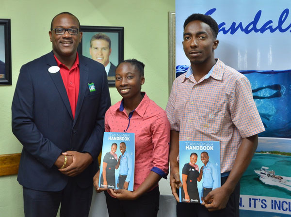 img: (From left to right) Regional Group Manager for Human Resources and Training, Ryan Matthew, with new Sandals interns Kerraul Morgan and Shane David at a recent meeting at Sandals Halcyon Beach Resort.