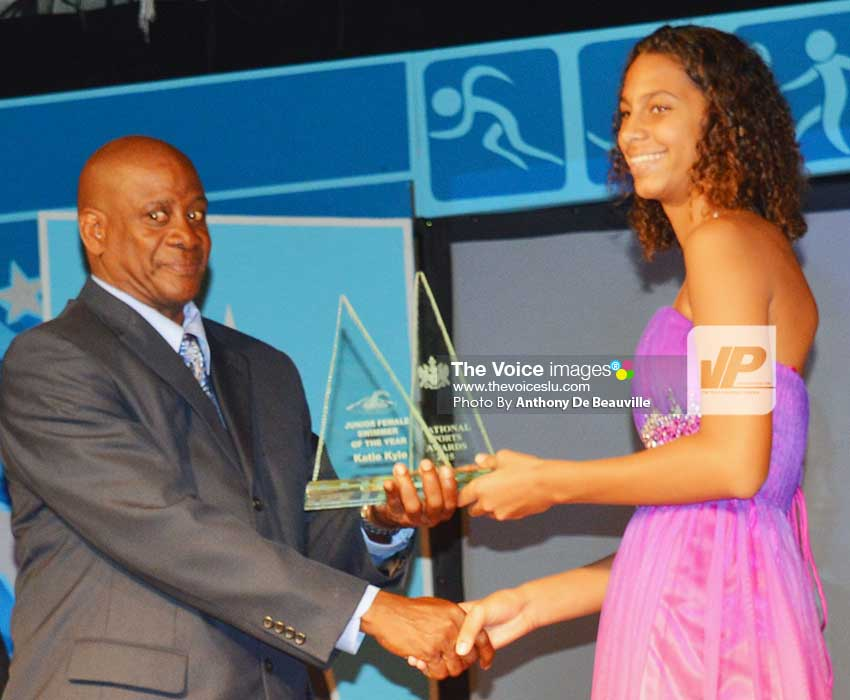 Image: (l-r) PS Sports Donavan Williams presenting Katie Kyle with the Junior Sportswoman of the Year award; Katie makes a clean sweep at SLASA awards. (Photo: Anthony De Beauville)