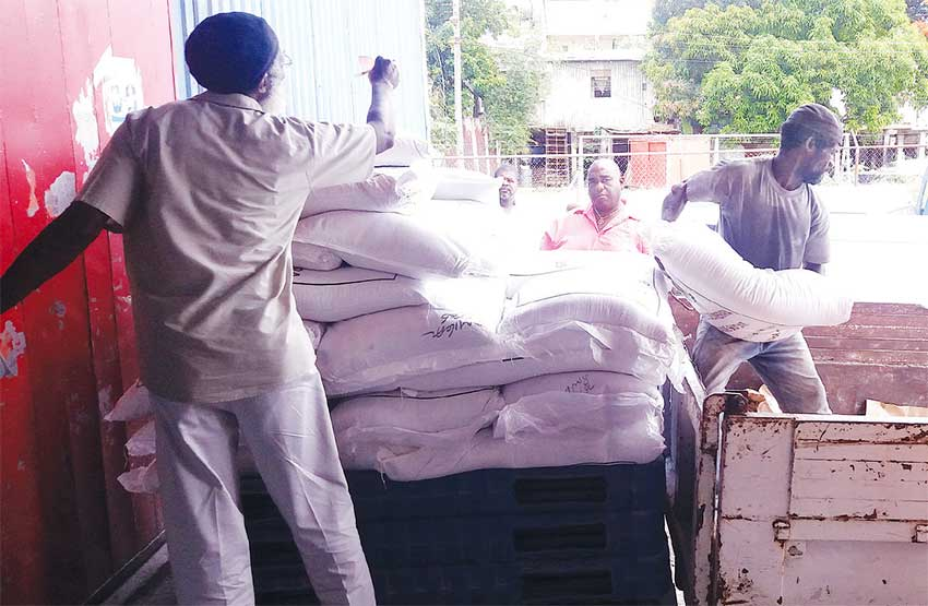 Image of sugar being loaded for distribution