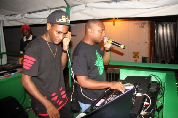 Image of DJ Licence (left) spinning tracks last weekend.