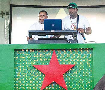 Image - DJ T-Boog and MC Sly Eli on stage.