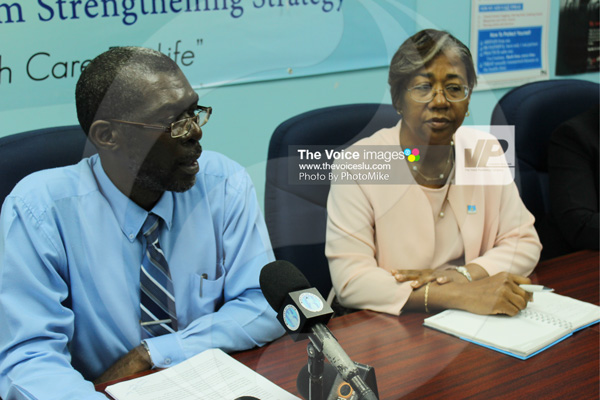 img: (L-R) P.S. St. Hill and Minister Isaac at Thursday's news conference. (Photo by PhotoMike)