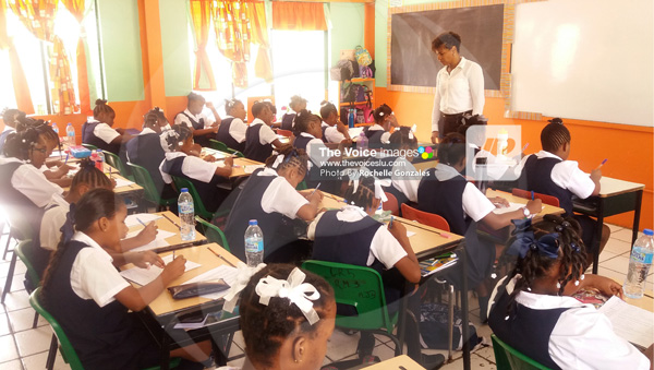 img: Class is in session at Ave Maria Girls Primary last Monday.  [Photos By Rochelle Gonzales]
