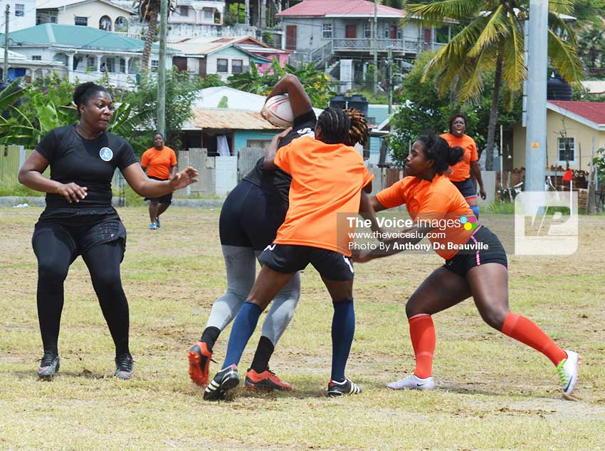 Image: Stingers' Signa President (on the right) in hot pursuit as Whiptail Warriors' Jermiah Evariste (with ball in hand) heads for a try