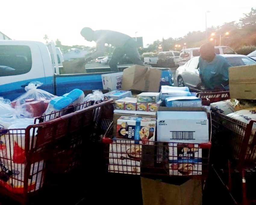 Image: Team Flow Saint Lucia working to load supplies for Dominica.