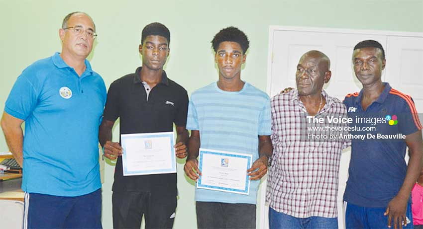 Image: (L-R) Vincent Boland -Team Manager, Rio Longville and Yannick Noel (goal scorers against Guyana); Albert St. Croix (Head Coach) and CesPodd, SLFA Technical Director. (PHOTO: Anthony De Beauville)