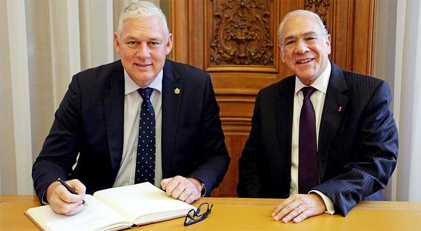 Image: Prime Minister Allen Chastanet with OECD Secretary General, Angel Gurria.