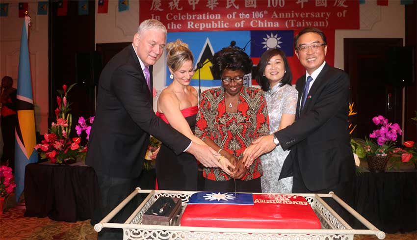 Image: Ambassador Shen and his wife, Ling-hon (far right) cut the ceremonial cake with Governor General Dame PearletteLouisy and Prime Minister Chastanet and his wife, Raquel, last Friday evening.