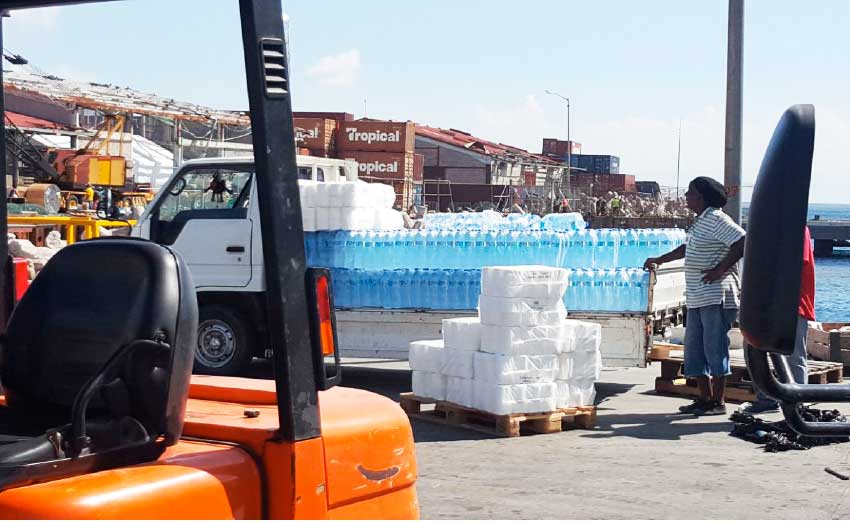 Image: Bottled water was among the essential items delivered to Dominica on the recent trip.