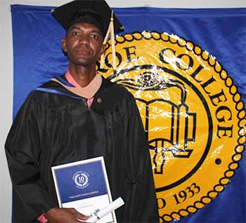 Image: Monroe College staffer, Erwington Maximin, earned his Bachelor's Degree in Criminal Justice after five years of hard work and dedication.
