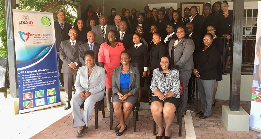 Image: Front row (L-R) : Gloria Augustus, Technical Specialist, JJRP2, OECS Commission; Simone Brown, Education Development Officer, USAID ESC; Her Ladyship Honourable Gertel Thom, Justice of Appeal and Chairman of Judicial Education Institute of the Eastern Caribbean Supreme Court. Also pictured are High Court Judges, and administrative representatives of the Eastern Caribbean Supreme Court, Magistrates of the OECS, OECS Bar Association, and OECS Ministry of Justice representatives.