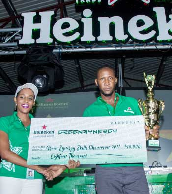 Image: The 2017 Heineken Green Synergy Winner X Factor receiving his cheque from WLBL Junior Brand Manager, Global Brands, Mindy Luquiana Chicot.