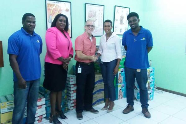 Image: J.E. Bergasse & Company Ltd. (JEB) handover to the Rotary Club of Saint Lucia (RCSL). (from left to right): Nicholas Charlemagne -- JEB Rep; Selma St. Prix, IPP RCSL; Anthony Bergasse, Managing Director; Joanna Charles, President, RCSL and Kervin Antoine, JEB Rep.