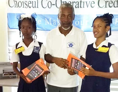 Image of Les Etangs Combined School with Mr. Christopher Combie of the CCCUL Education Committee.