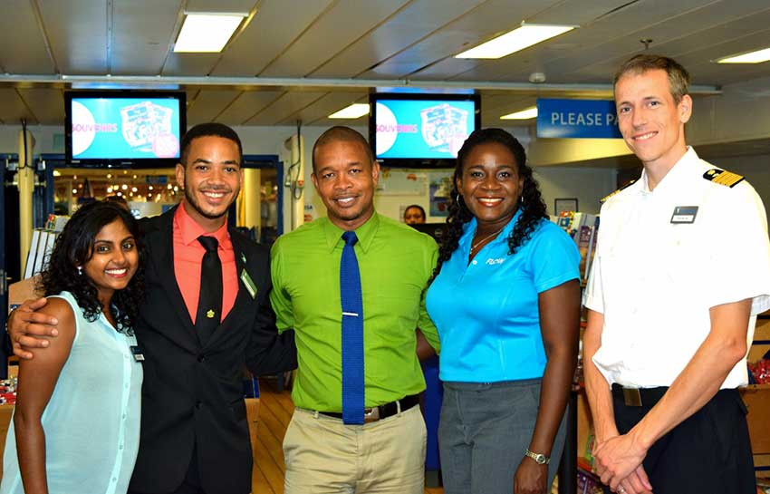 Image: Malerie Pillay and Brandon Kemp of the Logos Hope, Terry Finisterre and Adriana Mitchel-Gideon of Flow Saint Lucia, and Captain Samul Hils.