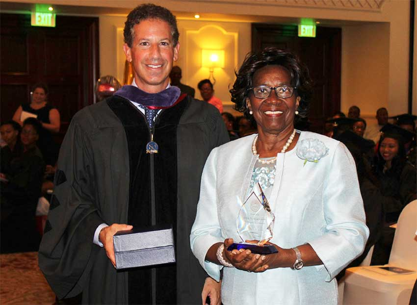 Image: Monroe College President, Marc Jerome, presents Dame Pearlette with a plaque of appreciation.