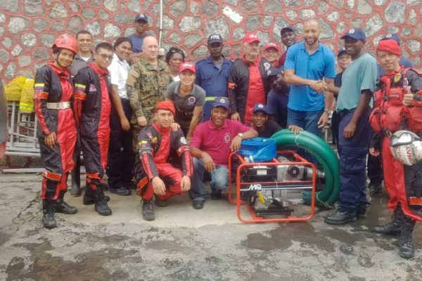 Image: Members of the Dominican fire brigade and personnel from the Colombian and Mexican fire- fighting teams have flown into Dominica to help their colleagues.