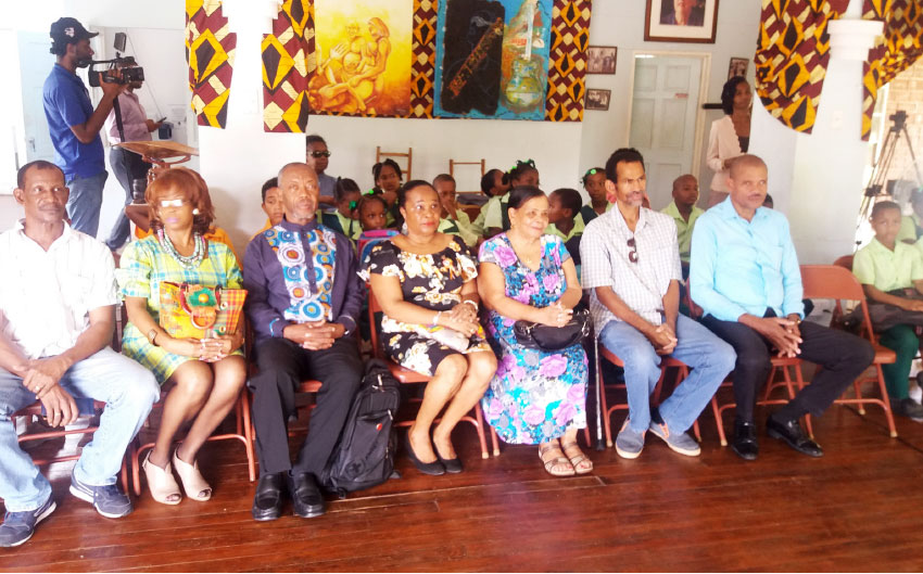 Image of The St. Omer Family alongside PABA, Teachers and Students