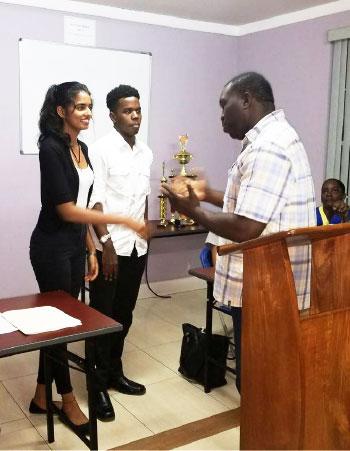 Image: Head Judge, Zachary Hippolyte, congratulates the winners.