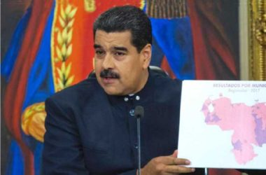 Image of Maduro showing a map of Venezuela depicting the states his party won in Sunday's elections.