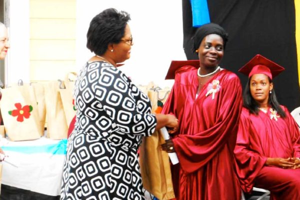 Image: A graduate receives her certificate.