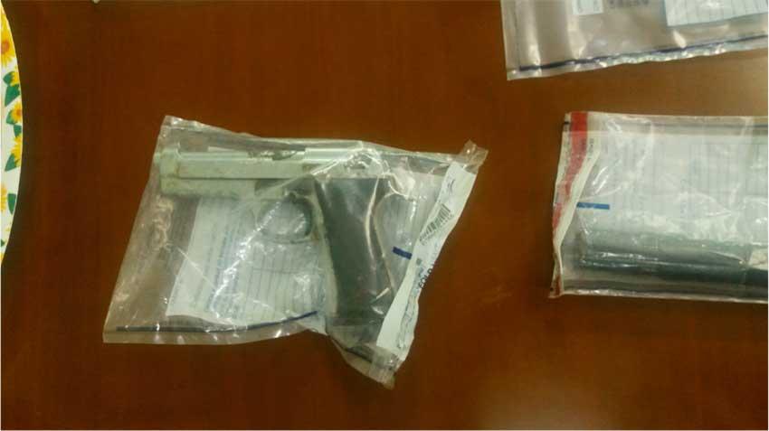 Image: Gun and Taser Seized.