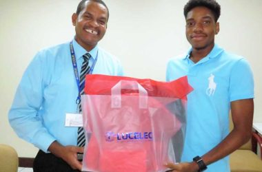 "Image:""The LUCELEC sponsored 2017 SPISE student receives a token from LUCELEC Corporate Communications Manager Mr Roger Joseph"""