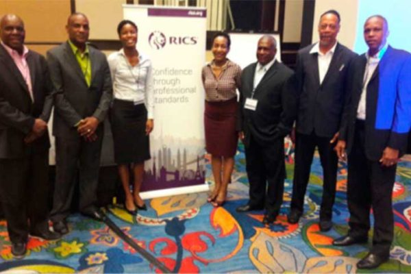 Image: Tedburt Theobalds, Andre Mathurin, Marissa Justin, Theresa Alexander-Louis, Rufinus Baptiste (ISSL President), Celsus Baptiste and Winsbert Felix at the RICS/IPTI Conference in Trinidad & Tobago.