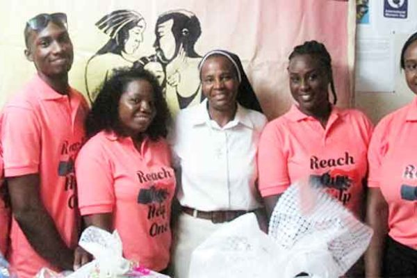 Image: The SALCC students with a Crisis Centre staffer at the presentation ceremony.