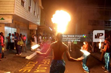 Image of a fire eater spits a mouthful of flames near Constitution Park. [PHOTO: Stan Bishop]