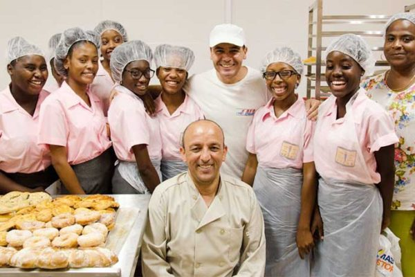 Image: Bakers Michael and Ali with students from Vieux Fort Comprehensive Secondary School.