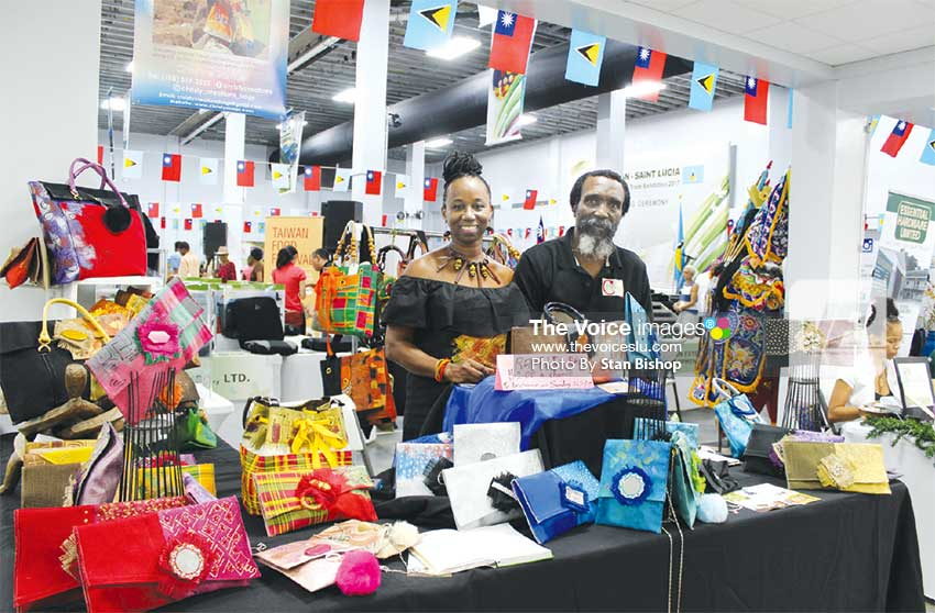 Image: Christine Samuel and hubby, Kennedy, at their colourful booth. [PHOTO: Stan Bishop]