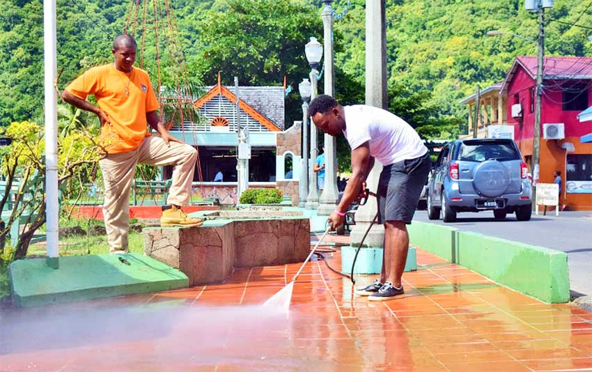 Image: Flow colleagues spent much of the day pressure washing the Soufrière waterfront park.