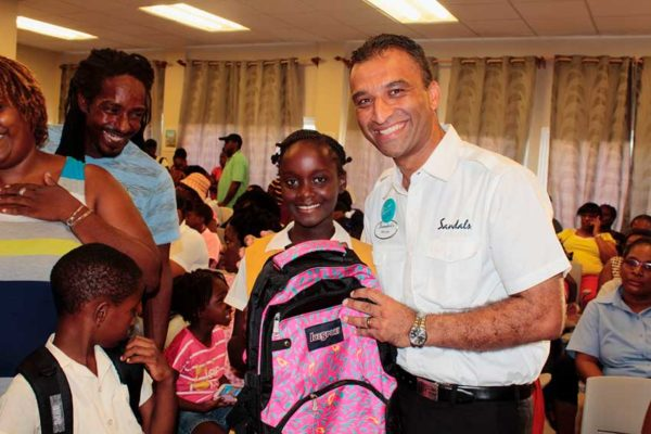 """Image: Sandals Grande Antigua General Manager, Gaurav """"G"""" Sindhi, made a personal commitment to ensure that each child present received supplies."""