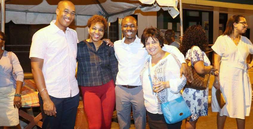 Image: Minister Fedee, Bay Gardens' Sanovnik Destang, and SLTA's Agnes Francis et al enjoying the moment at last week's Friday's Anse La Raye Fish Friday.