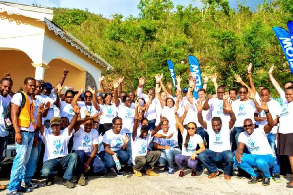 Image: Mission Accomplished! C&W CEO John Reid celebrates with members of his executive team and the colleagues of Flow Dominica on the completion of their Mission Day 2017 Volunteer activity in Dominica at CHANCES.