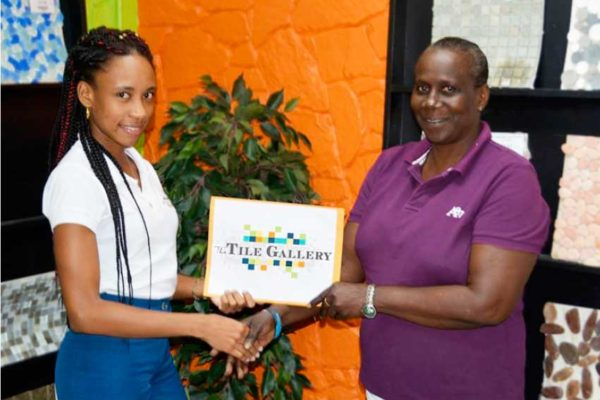 Image: Ms. Tiphanie De Beauville, Customer Service Representative, and Ms. Eugenia Daniel.
